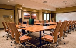 Conference table with seating in modern office building.